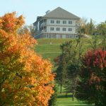 Lenape Inn from a distance with fall trees in the foreground